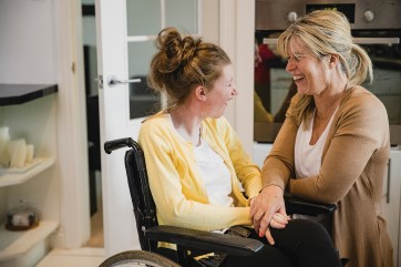 Disabled girl wheelchair with mum