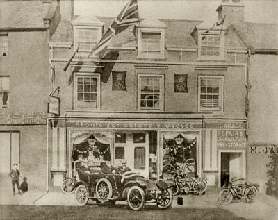 First car in Egremont outside Stout`s Motors and Cycles Garage, 1911