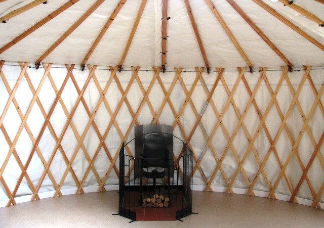 Yurt interior with stove